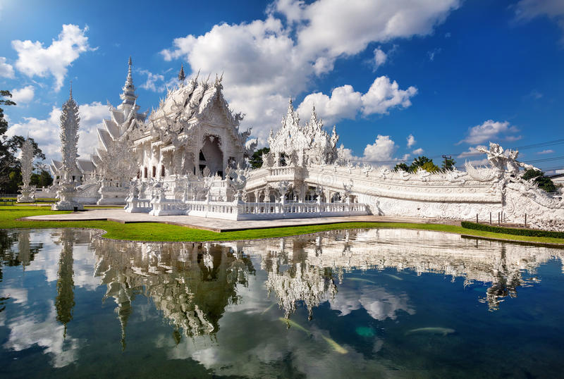 White Temple in northern Thailand. Wat Rong Khun The White Temple and pond with fish, in Chiang Rai, Thailand stock photos