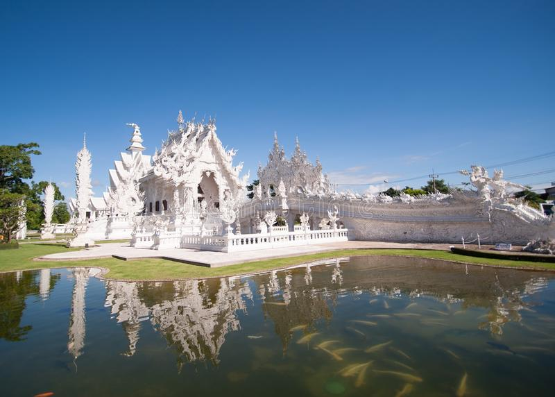 White Temple 2. A popular tourist destination in Chiang Rai, Northern Thailand. Tours run daily from Chiang Mai and Chiang Rai and this is one of the stops stock photo