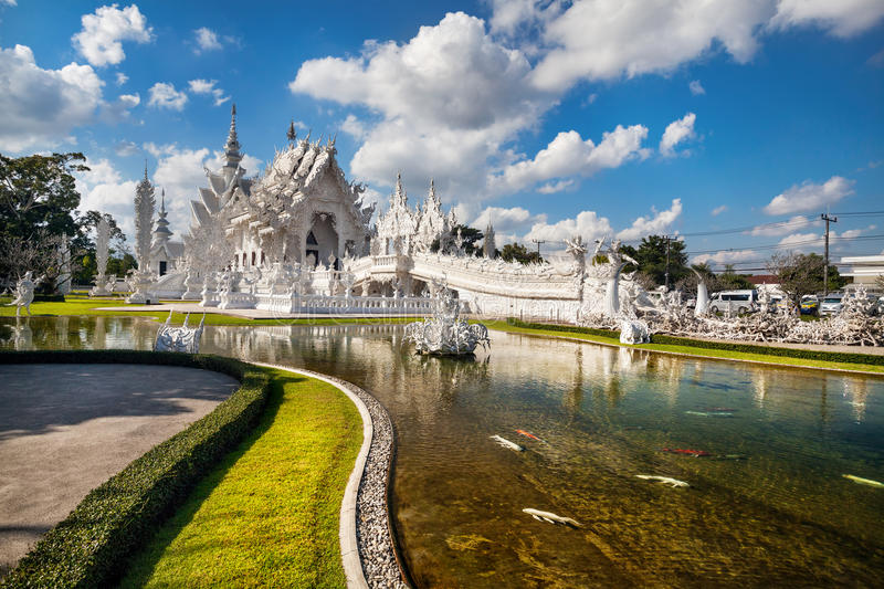 White Temple in Thailand. Wat Rong Khun The White Temple and pond with fish, in Chiang Rai, Thailand royalty free stock photo