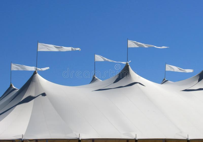 White Tent With Waving Flags Royalty Free Stock Photos