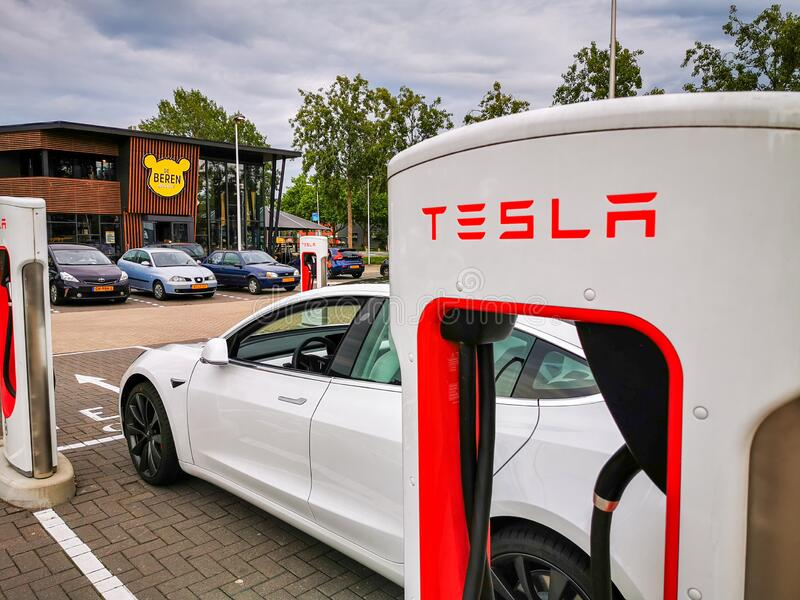 Tesla Supercharger near restaurant stock image