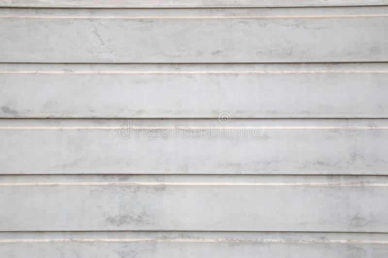 White texture concrete wall fence is strong. Made with concrete slabs overlapping each other into layers of a house fence. Concept stock images