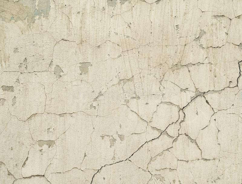 Texture old concrete wall with remains of plaster with cracks. White texture old concrete wall with remains of plaster with cracks stock photos