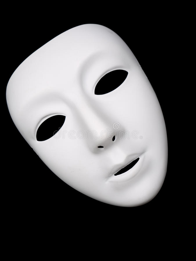 White theatrical mask on black background stock photography