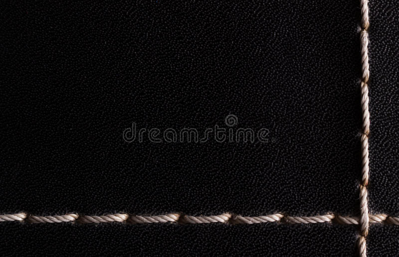 White thread stitching on black leather. royalty free stock image