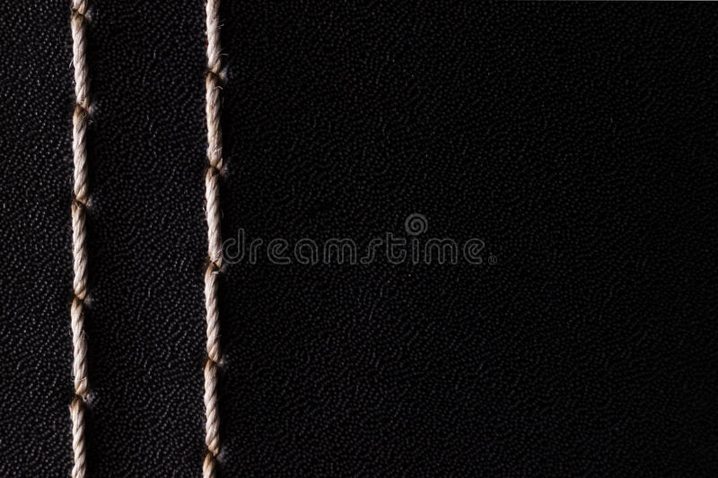 White thread stitching on black leather. royalty free stock images