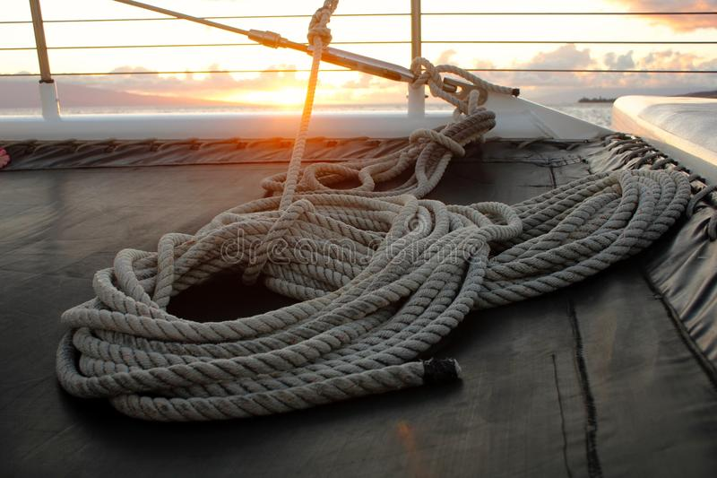 White Tight Rope Near a Brown Surface during Sun Set royalty free stock photo