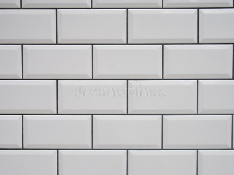 White tile with black joints. Texture stock image