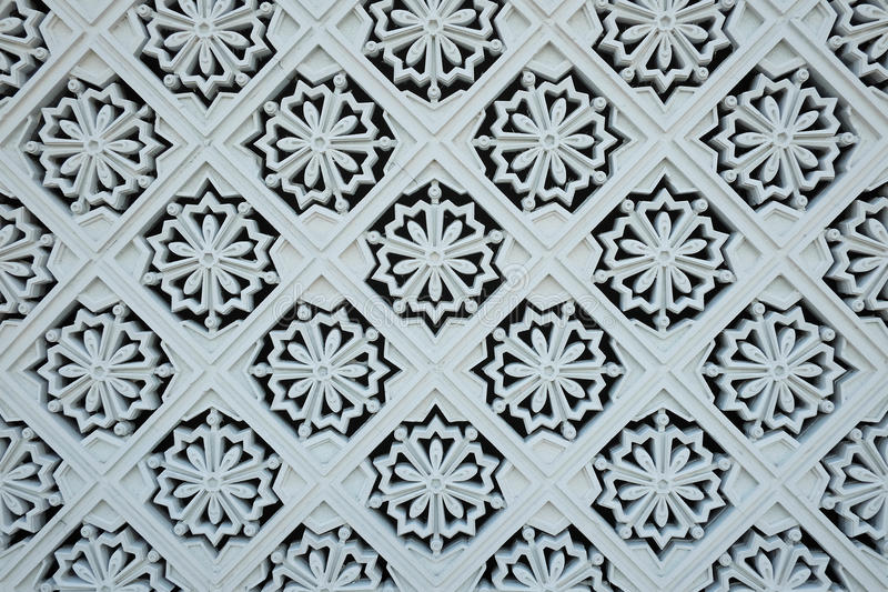 White tile decorations on the outer wall of the New Royal Palace royalty free stock image