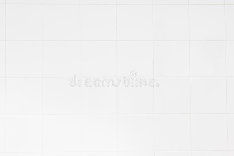 White tile wall/White tiles wall background with the morning sun at windows reflect using classical background or use it in design. White ceramic tile wall/White royalty free stock images