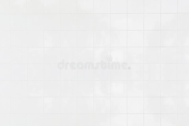 White tile wall/White tiles wall background with the morning sun at windows reflect using classical background or use it in design. White ceramic tile wall/White stock images