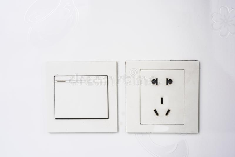 White tiled wall switch and socket stock image
