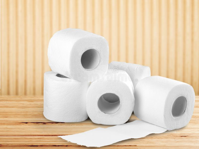 White Toilet Paper rolls on beige. Paper toilet rolls objects blue background royalty free stock photos