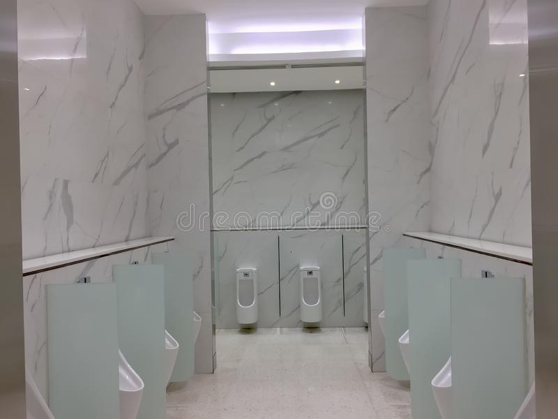White toilet urinal in modern restroom,new lavatory with marble style.  royalty free stock photography