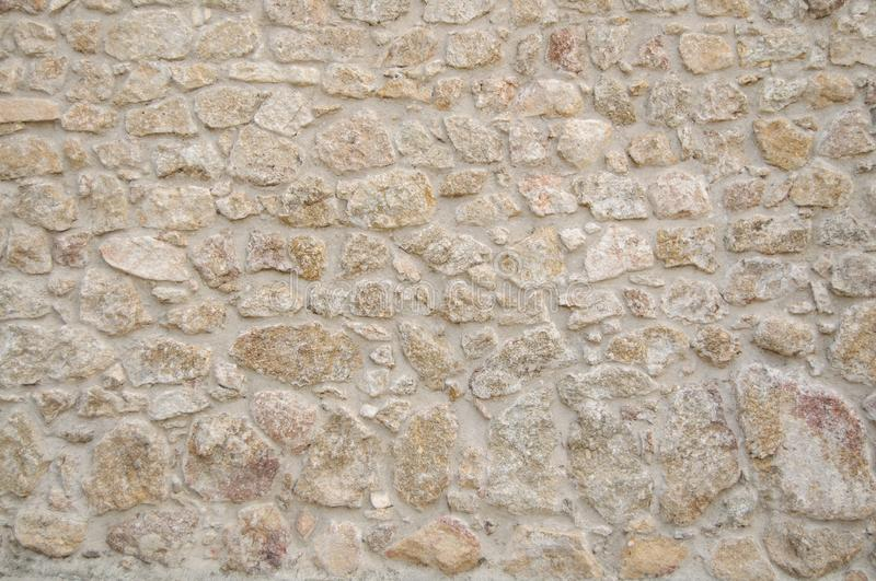 White tone Wall Texture for Background and Design Art Work. Simple grungy stone wall as seamless pattern texture background or as art design overlay. Building royalty free stock photos