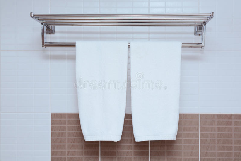 White Towel hanging on Bathroom wall with hanging towel stock photo