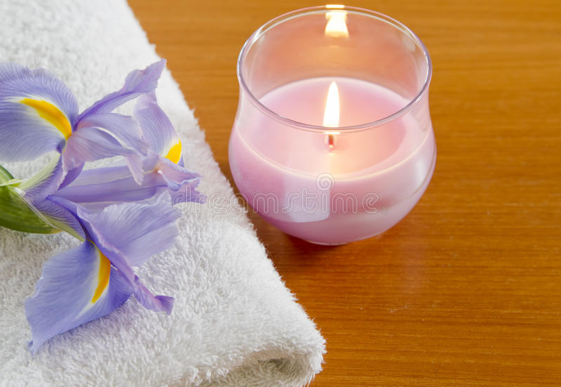 White towel with purple iris stock photos
