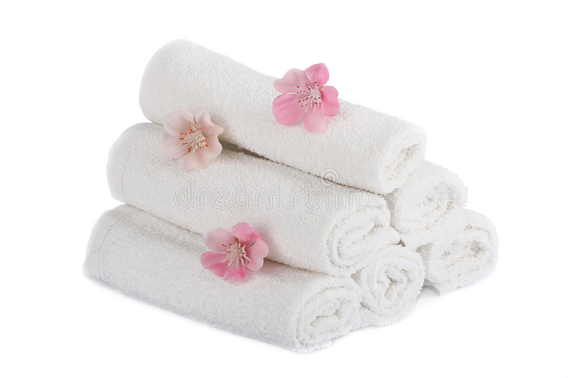 White towels and aromatic flowers isolated royalty free stock images