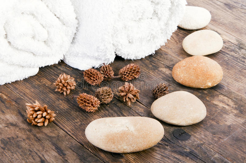White towels and stones next to each other. stock images