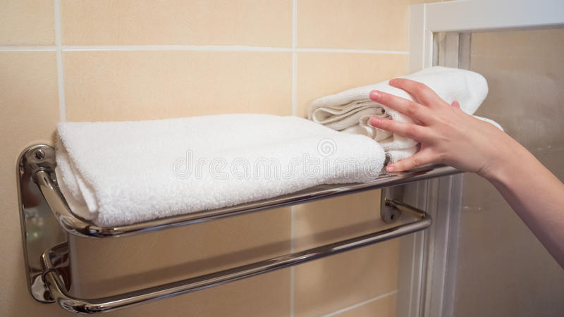 White towels takes the human hand stock photos