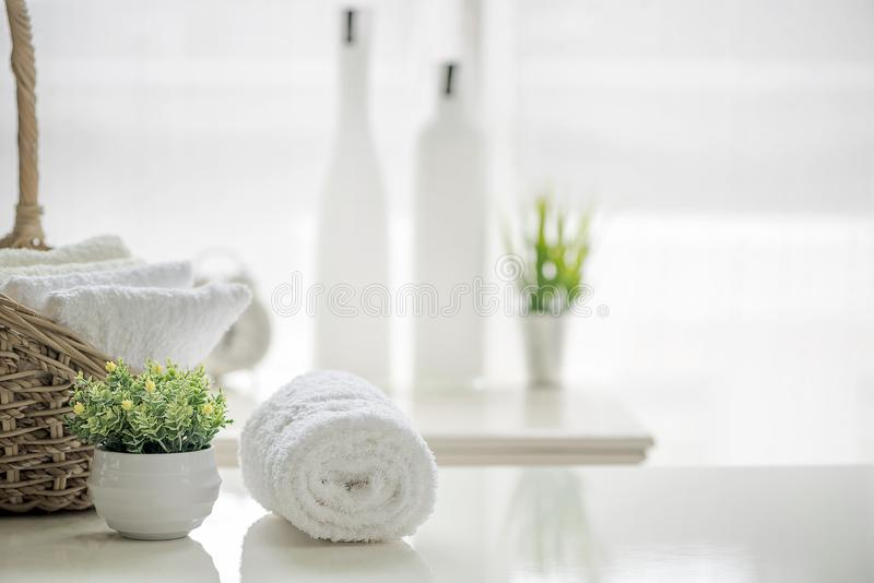 White towels on white table with copy space on blurred bathroom stock photo