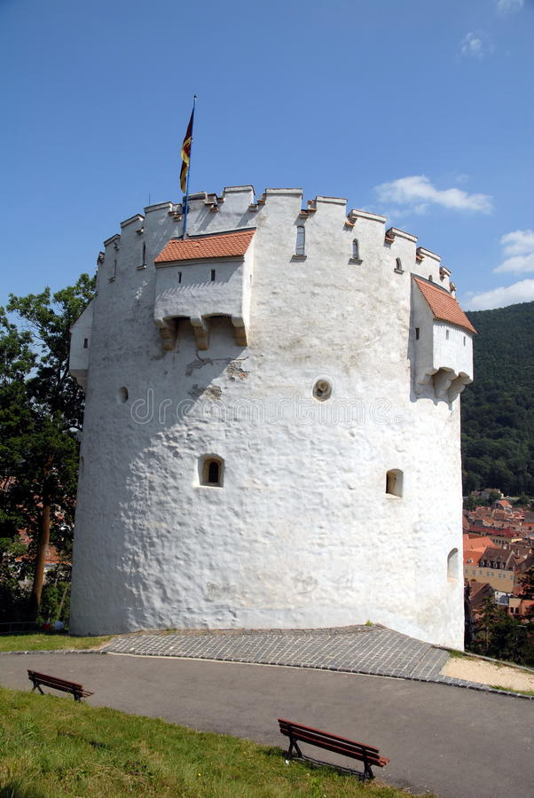 The White Tower from Brasov, Romania. (romanian Turnul Alb) is located 60 m far from the citadel's walls, near the Graft bastion. It is high up on the hill and royalty free stock images