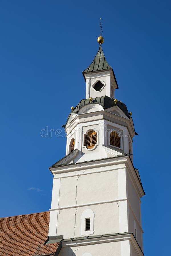 St Erhard church Brixen Bressanone , Italy. White tower of St Erhard church Brixen Bressanone, Italy. Sunny day and blue sky royalty free stock image