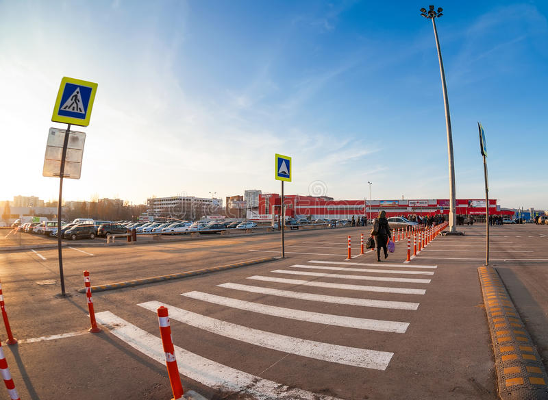 White traffic markings with a pedestrian crossing on a gray asp. SAMARA, RUSSIA - SEPTEMBER 23, 2015: White traffic markings with a pedestrian crossing on a gray stock image