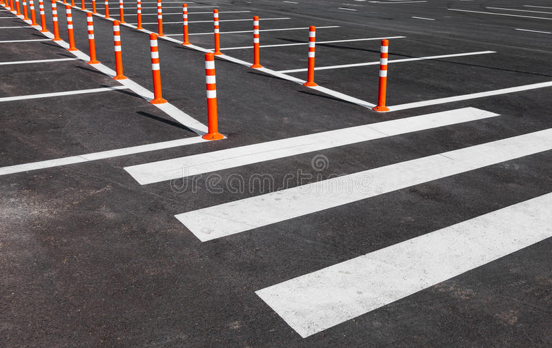 White traffic markings with a pedestrian crossing. On a gray asphalt parking lot royalty free stock photography