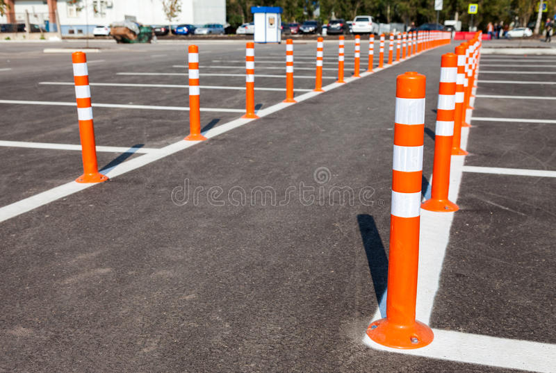 White traffic markings with a pedestrian crossing. On a gray asphalt parking lot royalty free stock images