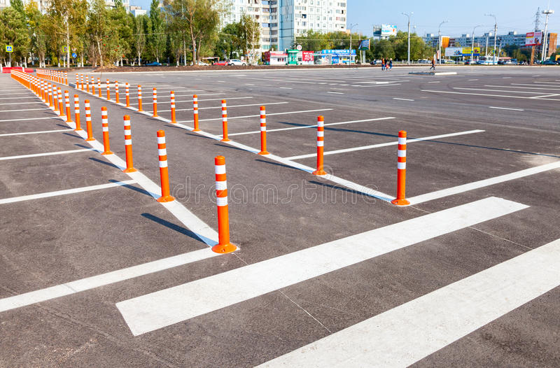 White traffic markings with a pedestrian crossing on a gray asphalt. SAMARA, RUSSIA - SEPTEMBER 21, 2014: White traffic markings with a pedestrian crossing on a royalty free stock image