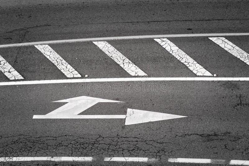 White traffic sign painted in asphalt stock image