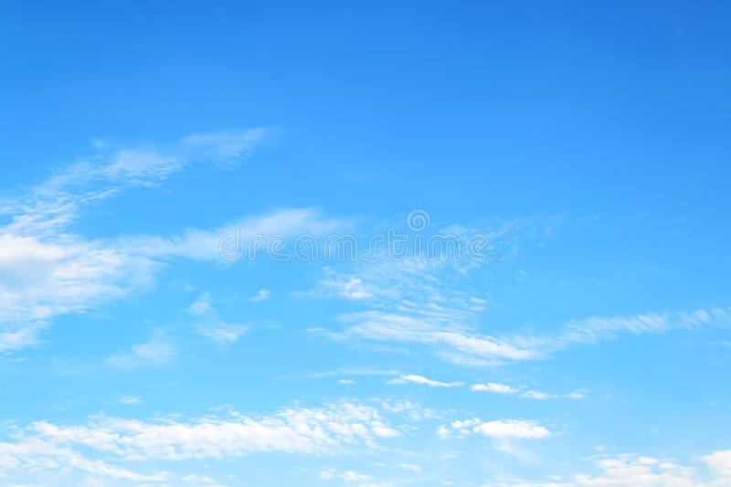 White translucent cirrus and stratus clouds high in the blue summer sky. Different cloud types and atmospheric phenomena stock photo
