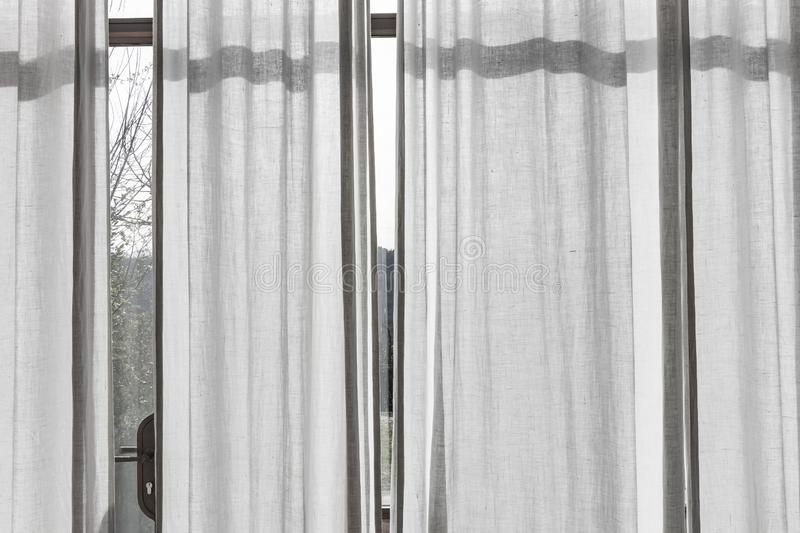 White translucent curtains on a big window. Indoor view stock photo
