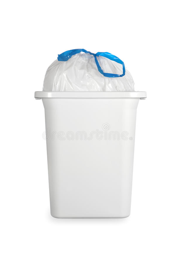 White trash can with plastic garbage bag stock image
