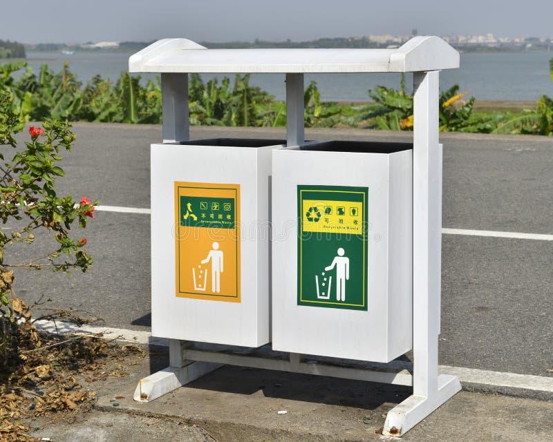 White trash can on roadside,dustbin,garbage bin, garbage can stock photos