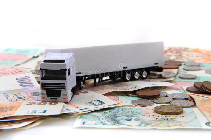 White truck and czech money. Isolated on the white background royalty free stock photo