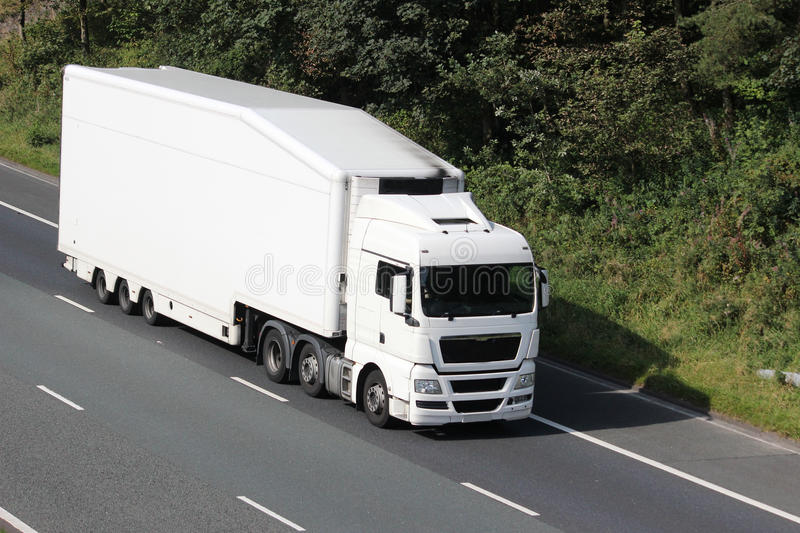 White truck on motorway in countryside royalty free stock image