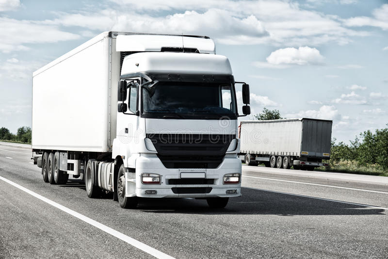 White truck on road. Cargo transportation royalty free stock images