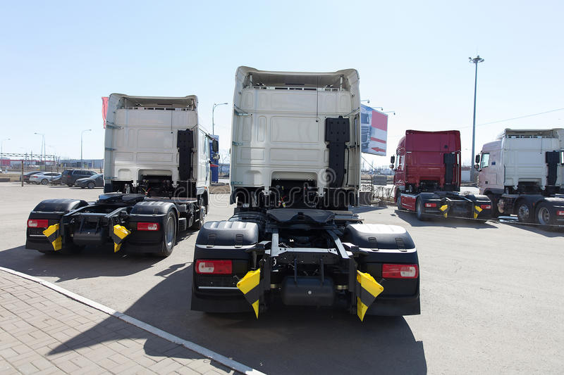 White trucks stand in line royalty free stock images