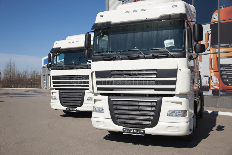 White trucks stand in line stock images