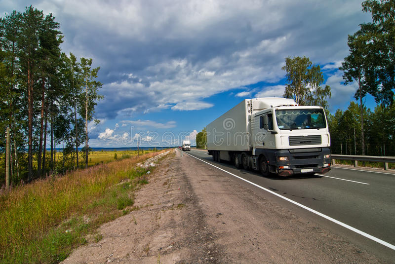 Download White Trucks Traveling On The Highway Stock Image - Image of industry, moving: 17072843