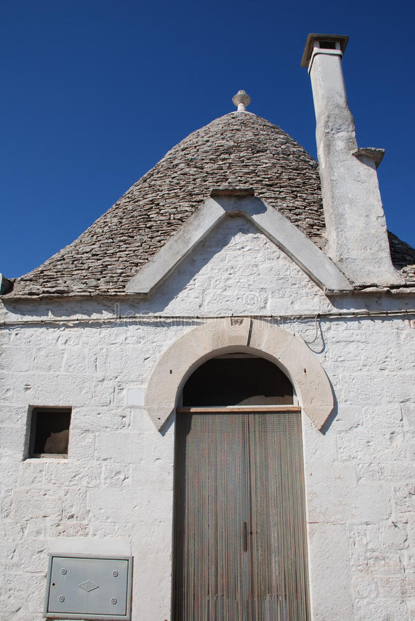 White Trullo, South Italy. A traditional trullo house in Alberobello in Puglia, southern Italy. The trulli, which are protected under UNESCO World Heritage laws royalty free stock photo