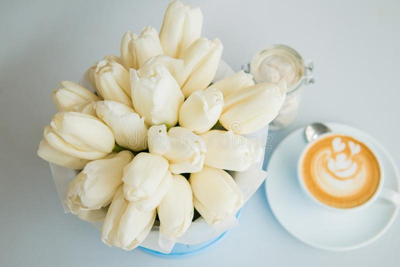 White tulips and coffee stock photography