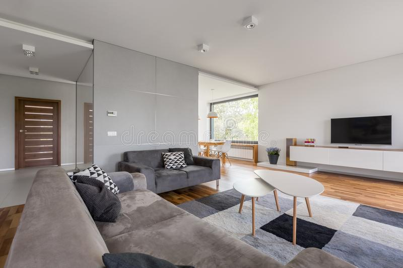 Tv living room with sofa stock image