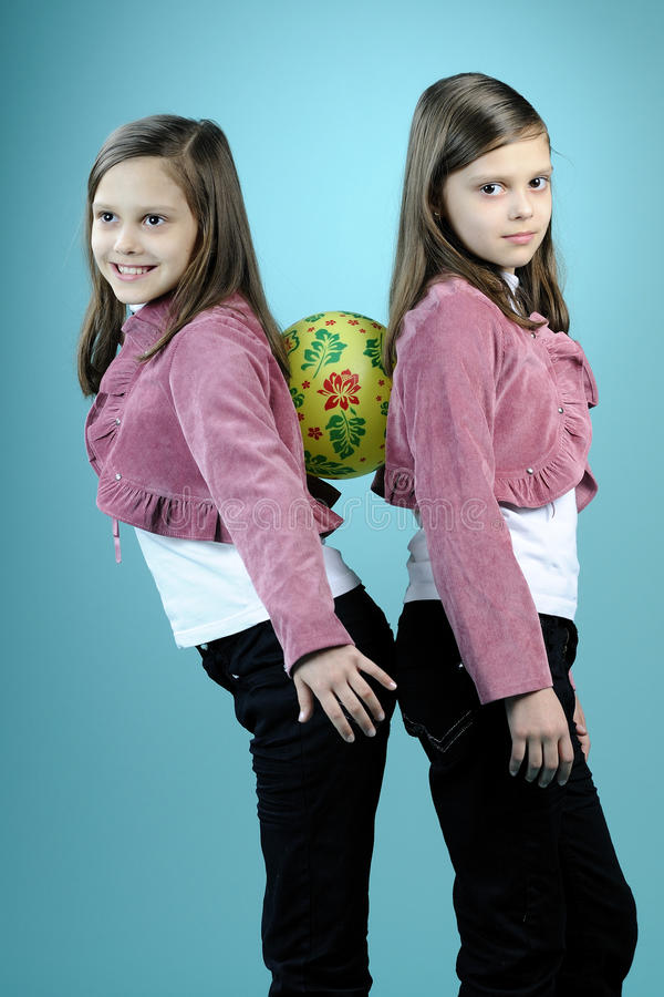 Download White Twin Sisters Having Fun With Ball Stock Photo - Image: 13461620