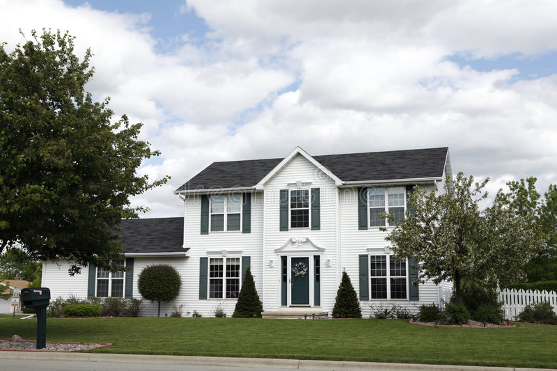 White two-story home. Typical suburban two-story home with nicely landscaped yard stock photos