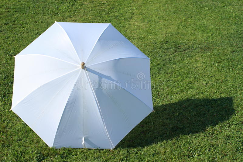 White umbrella royalty free stock photo