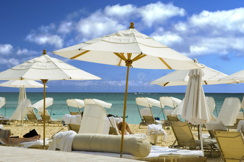 White umbrella beach royalty free stock images