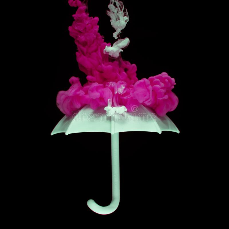White Umbrella And Pink Smoke royalty free stock images